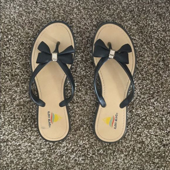 650f86eec Aloha Island Shoes - Tan and black flip flops with bow