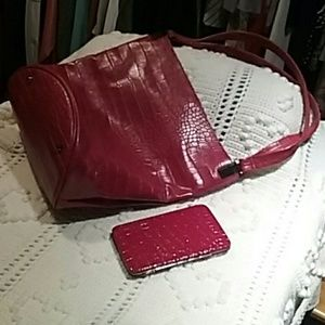 Purse is French connection  and wallet is not