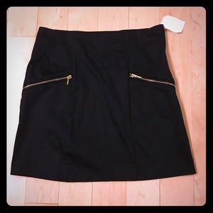 H&M Dresses & Skirts - H&M black skirt with gold zippers size 12 BNWT
