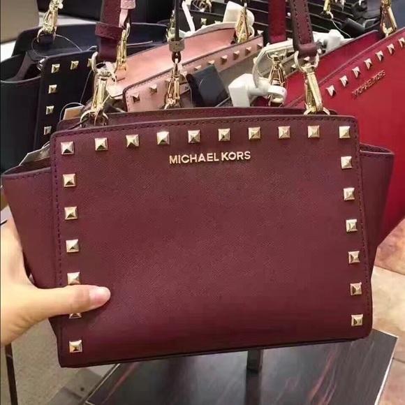 e73258fcf814 Michael Kors Bags | Selma Medium Studded Messenger Merlot | Poshmark
