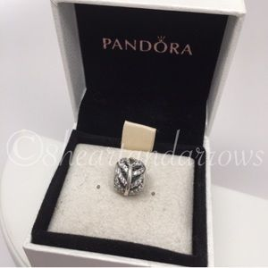 Pandora retired light as a feather cz charm