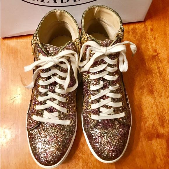 3ca523d3da1 ... Glitter high-top sneakers. Steve Madden. M 594c71a178b31cdaa304d893.  M 594c7360bf6df594f8025740. M 594c7362522b451afe04ce6a.  M 594c736441b4e03f4d0260b5