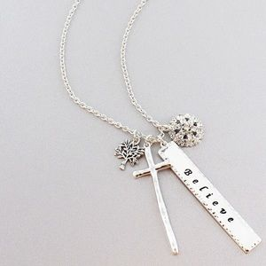 " Silver tone ""believe"" bar and cross necklace"