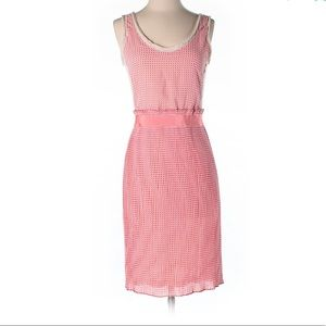 Sleeveless pink dress with ribbon ties in the back