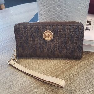 Michael Kors Handbags - Micahel Kors Mongram Zip Aroumd Wallet Wristlet