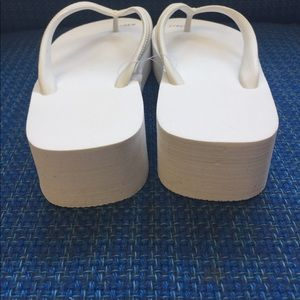 a382cda07536f6 J Crew Shoes - J Crew white wedge thong style flip-flops size 9