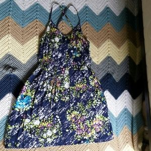 Red Camel Dresses & Skirts - A dark blue with floral pattern dress.