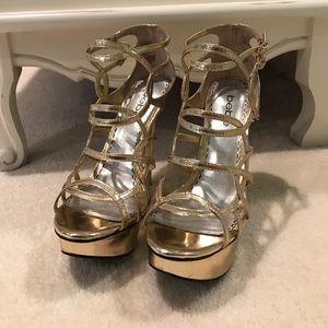 Gold Bebe high heels
