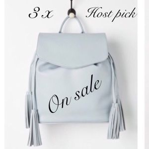 Light blue tassel backpack