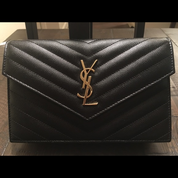 b3f43d868c80 BNWOT YSL small WOC black with gold hardware. M 595067f42de512f6da029658