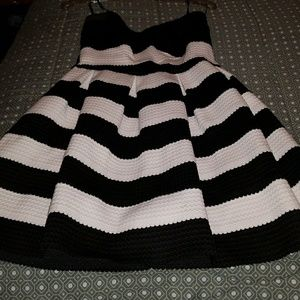 Used once black and white strapless mini dress