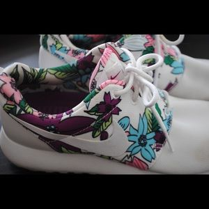 White Nike Roshe shoes with floral detailing