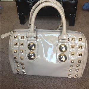 Aldo studded patent leather handbag