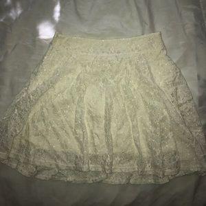 Cream lace skirt.