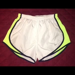 White and neon yellow Nike dri fit tempo shorts