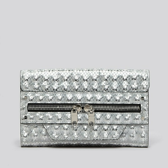 bd1924c784 Milly Bowery silver geometric holographic clutch. M_5951dd189c6fcfe23e0ad2aa