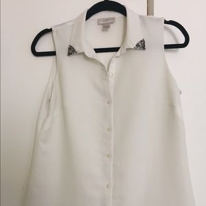 White button-down blouse with embellished collar.