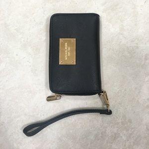 Handbags - MICHAEL KORS black wristlet wallet. Lightly used.