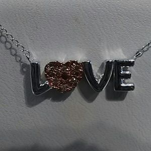 SOLD.   Diamond necklace sterling silver says love