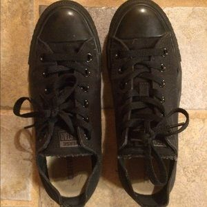 All black low top Converse size 7