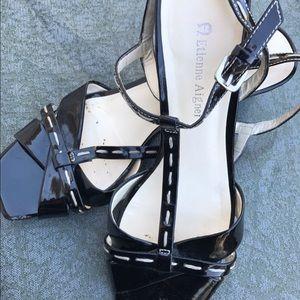 Etienne Aigner patent black sandal.