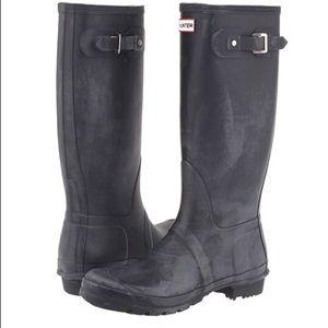 Distressed black tall hunter boots