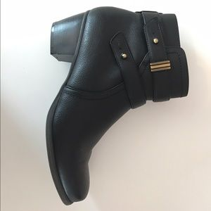 Black wedge ankle boots.