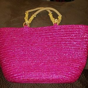 Pink straw bag with adorable rope handles.