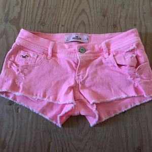 Pink distressed hollister shorts