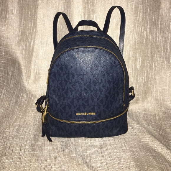 447443ae0bc1 Navy Blue Michael Kors Rhea Zip up Backpack. M_5953dd2d5a49d0e8be0016c2
