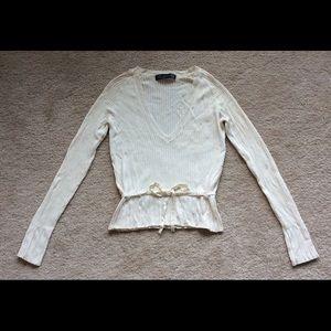 Woman's Zara sweater.
