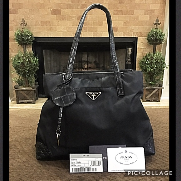 01391c7b219c Authentic Prada Bag with lock and key. M_595402526d64bc451c008e2d