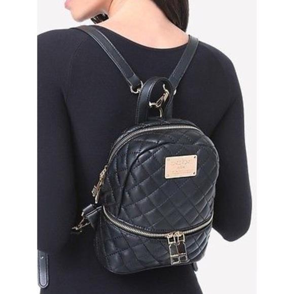 18abd0071d5b bebe Handbags - Authentic BEBE Danielle mini quilted backpack
