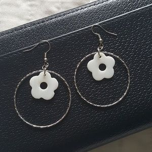 Silver hoop earrings with carved shell flower