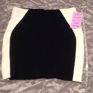 Potter's Pot Dresses & Skirts - Black with White Faux leather sides mini skirt