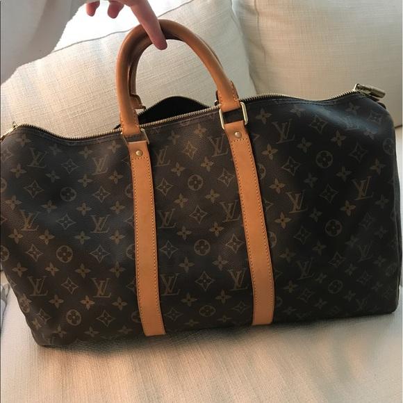 7fbdc486749e 48% off Louis Vuitton Handbags - Louis Vuitton Monogram Weekend Duffle Bag  from Emily&#