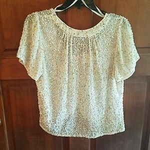 Sequin blouse with open back