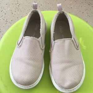 Pink slip on sneakers
