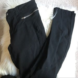 Used black pants with cute zippers