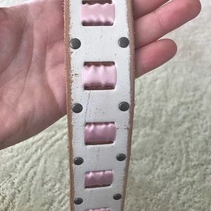 White leather belt with pink ribbon