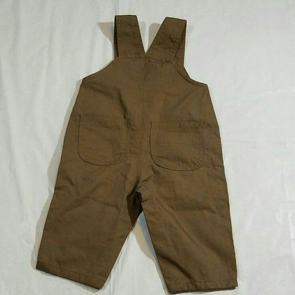 This is a shirt and pair of denim overalls from John Deere. They are infant boys size Months and are in excellent used condition. No rips or stains, smoke free home.