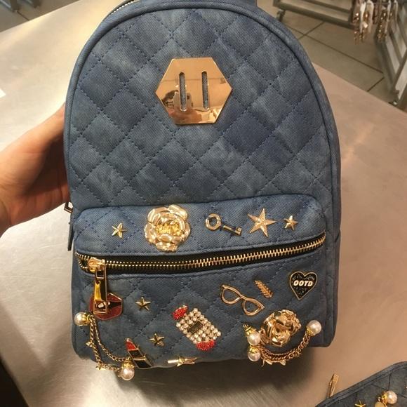 e6a326760605 Brand new aldo denim bookbag with charms