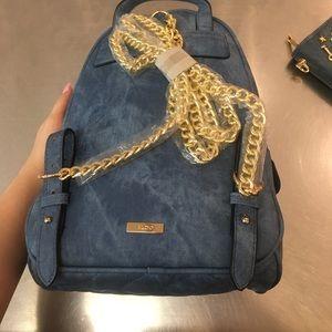 386730e102cd Bags - Brand new aldo denim bookbag with charms