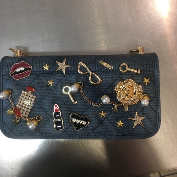 7cd03682702 Aldo Handbags - Denim aldo wallet with charms