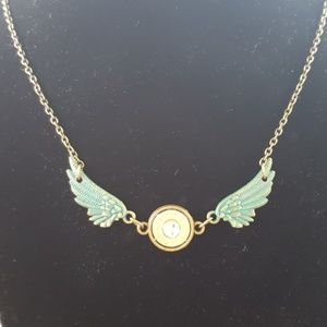 Jewelry - Bullet and wings necklace