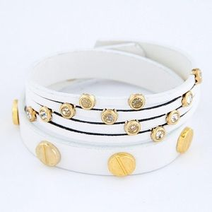 Jewelry - NWOT White leather wrap arm band w/ gold studs