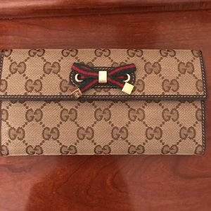 Gucci Bags - Gucci Continental Wallet with bow detail
