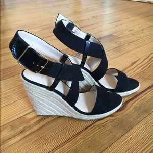 Worn once. Fabric upper and espadrille wedge.
