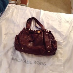 Authentic Michael Kors purse. Pockets on each end.