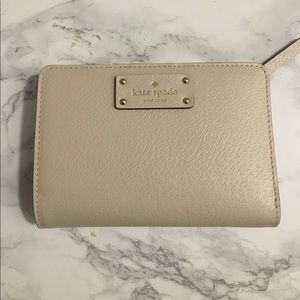 Nude snap front kate spade wallet